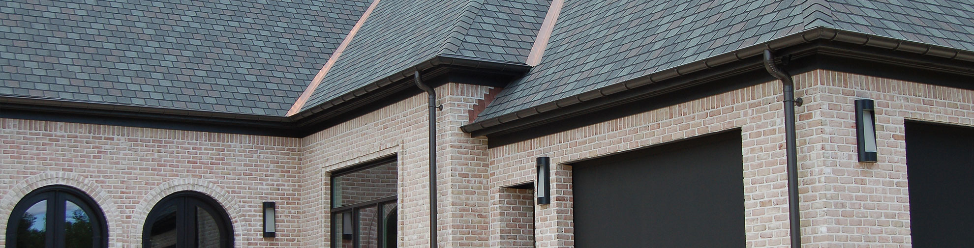 Bronze aluminum seamless half round gutters in Albany